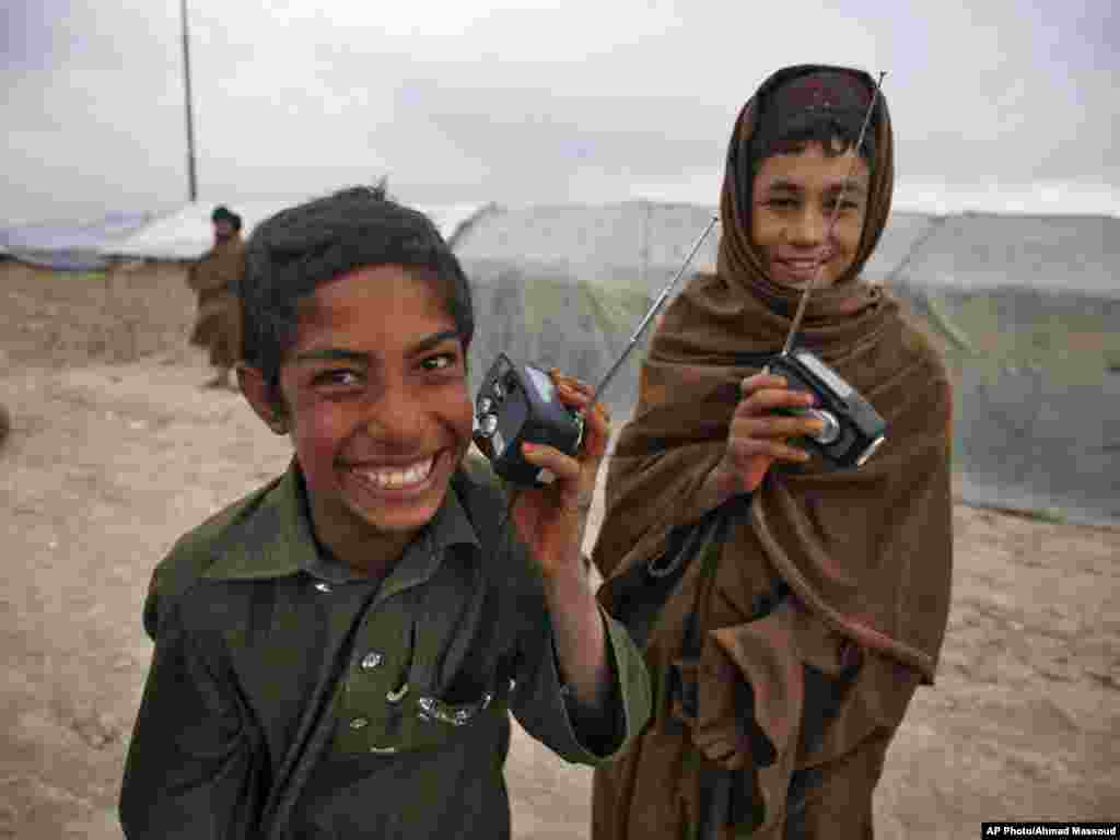 The radio distribution drive began on September 17 in a camp for internally displaced people on the outskirts of Kabul. These two boys were among the first to receive one of the 20,000 radios RFE's Afghan service Radio Azadi has since been distributing across the entire country.
