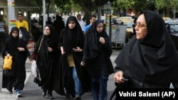 Iranian women are required by law to cover their hair and body in public. (file photo)