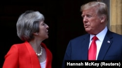 British Prime Minister Theresa May poses for a photograph with U.S. President Donald Trump at Chequers in the U.K.