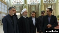 Iranian President Hassan Rouhani (2nd L) and his cabinet and office staff on May 25, 2019.
