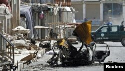 Debris from a car bomb in Kandahar after the clashes