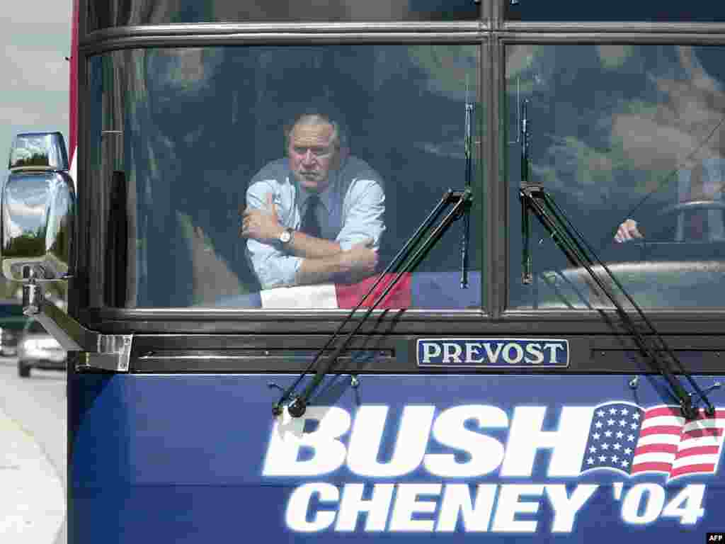 Election campaign 2004 - U.S. President George W. Bush looks out the window along the road in Waukesha County on July 14, 2004, as he kicks off a one-day campaign bus trip through Wisconsin.