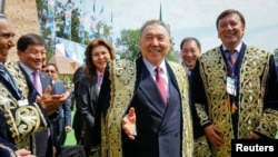 Many in Kazakhstan are worried that that a proposed new pantheon will be used to inter President Nursultan Nazarbaev (center) or other members of the current elite, not Kazakhs whose prominence has been defined by history.