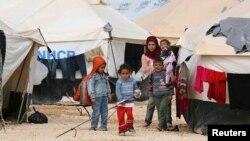 Сирийские дети в палаточном лагере для беженцев на территории Иордана. 6 марта 2013 года.