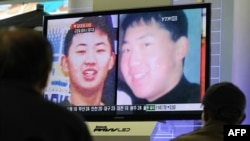 Men at a railway station in Seoul, South Korea, look at a television screen showing images of what is thought to be Kim Jong Un, the youngest son of North Korean leader Kim Jong Il on September 28.