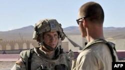 Staff Sgt. Robert Bales (left) is accused of killing 17 people on a shooting rampage on March 11.