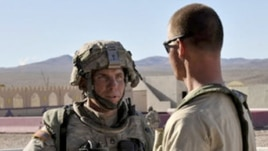 Staff Sergeant Robert Bales (left) is seen at a training center in Fort Irwin, California in an August 2011 photograph.