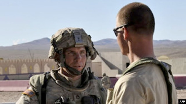 Staff Sergeant Robert Bales (left) is seen at the U.S. National Training Center in Fort Irwin, California, in an August 2011 image.