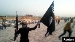 یک عضو گروه داعش در زمان تصرف شهر موصل در سال ۲۰۱۴