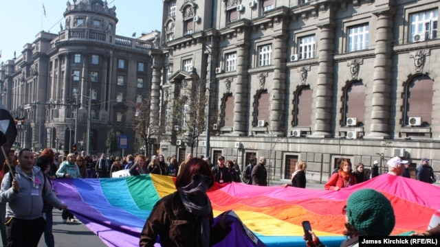 "Gay-rights acivists march in a gay-pride parade in Belgrade on October 10. Mirojlub Petrovic says he can ""cure"" gays with his ""original medicine."""