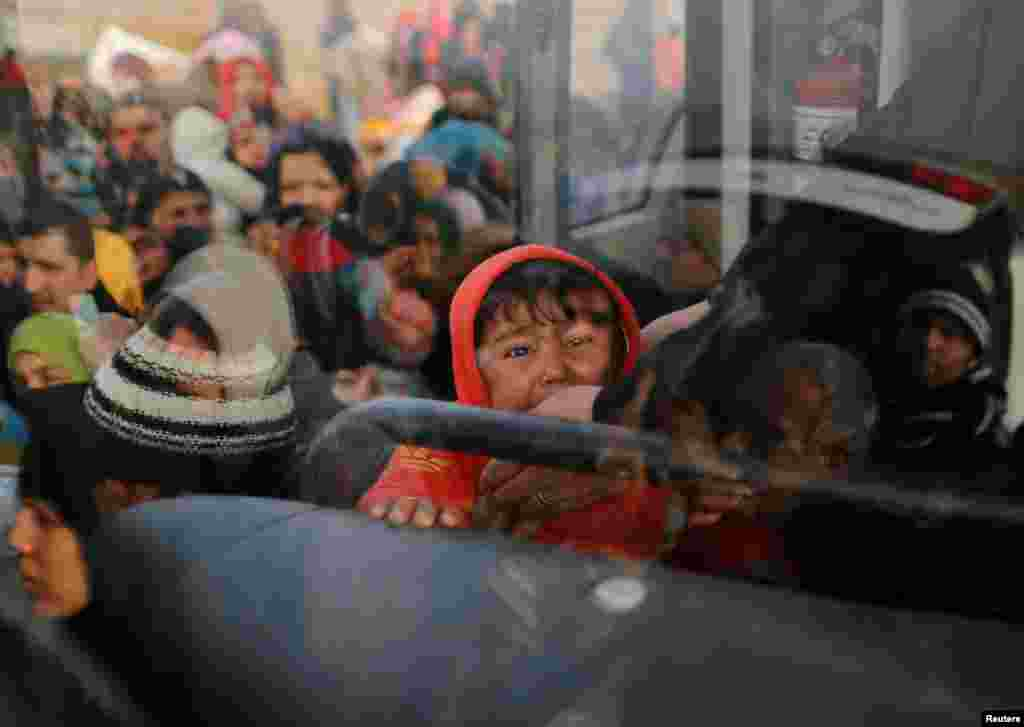 Iraqis flee the Islamic State stronghold in the town of Bartella, east of Mosul, on December 28. (Reuters/Ammar Awad)