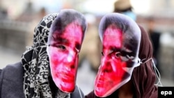 Afghanistan -- Afghan women wear mask of Farkhunda Malikzada, an Afghan woman who was stoned to death by a mob, Kabul, March 17, 2016