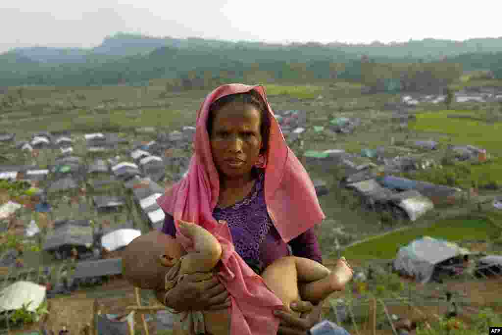 A Rohingya Muslim woman from Burma and her baby are shown after arriving at a new camp for refugees in Unchiprang near the Bangladeshi border town of Teknaf.  (AFP)