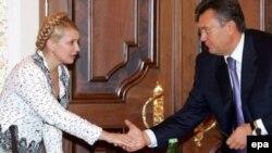 Jailed Ukrainian ex-Prime Minister Yulia Tymoshenko (left) talks with President Viktor Yanukovych in 2006.