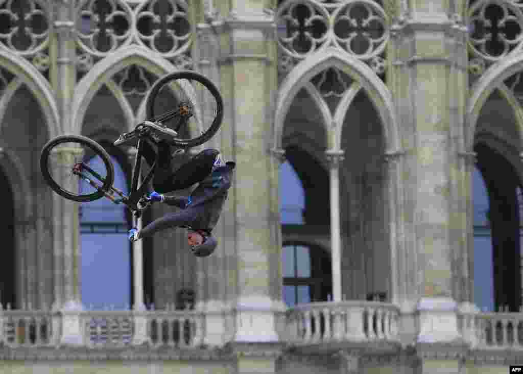 A participant practices with his bike during Red Bull's Vienna Air King freestyle event held in front of the Rathaus in Vienna. (AFP/Alexander Klein)