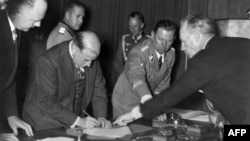 Edouard Daladier rüsvayçı Münhen sazişini imzalayır, 1938