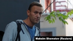 Russian opposition leader Aleksei Navalny leaves a Moscow court after a hearing on August 27.