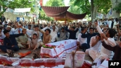 Pakistani Shi'ite Muslims stage a protest on June 30 against the killing of their community members in twin bomb blasts at a market in Parachinar, capital of Kurram tribal district on June 24.