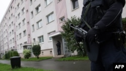 Policen officers secure a residential area in the town of Chemnitz in eastern Germany.
