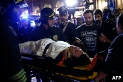 One of the 30 injured is evacuated from Piazza della Repubblica in central Rome.