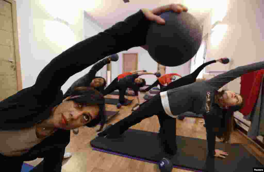 Pilates instructor Zainab Abbas (left) leads a class at her fitness studio in Lahore. Abbas opened her fitness studio, Route2Pilates, after receiving training in Bangkok, Thailand. She provides rehabilitation workouts for people with joint problems and specialised workouts for pregnant women.