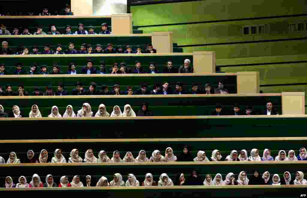 Iranian schoolgirls attend a parliament session in Tehran. (AFP/Atta Kenare)