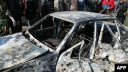 The state-run Syrian News Agency (SANA) released this photograph following the December 23 suicide car bombings in Damascus.