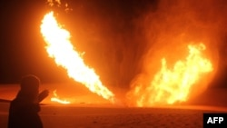 Flames rise during a previous attack on the pipeline on November 10.