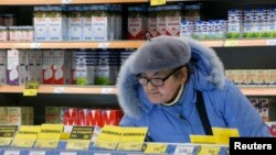 U.S. and EU sanctions over Moscow's interference in Ukraine have increased Russia's isolation, while the Kremlin's retaliatory ban has swept many Western foods off the shelves and driven inflation up.