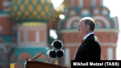 Russian President Vladimir Putin delivers a speech during a Victory Day parade in Moscow. This year, he has had to postpone the annual gala event due to the COVID-19 pandemic. (file photo)