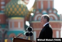 Russian President Vladimir Putin delivers a speech during the Victory Day parade on Red Square in Moscow on May 9 -- the last with Lenin present?