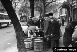 People form a line to buy herring in Kyiv.