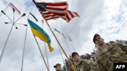 Ukrainian and U.S. soldiers attend the opening ceremony of the joint military exercise at the Yavoriv training ground in the Lviv region on April 20.