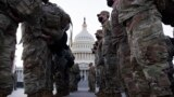 U.S. -- Members of the US National Guard gather on the grounds of the East Front of the US Capitol in Washington, DC, USA, 12 January 2021.