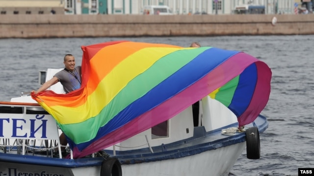An activist holds a rainbow flag during a gay pride event in St. Petersburg in June.