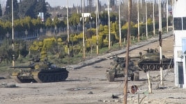 Syrian tanks are seen in Bab Amro near the city of Homs on February 12.