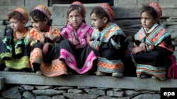 FILE: Kalash girls sitting outside their home in Kalash Valley, Chitral district in northwestern Pakistan's Khyber Pakhtunkhwa Province.