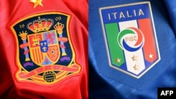 Ukraine -- A combo photo shows shows Spain (L) and Italian jerseys, 29Jun2012