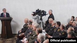 Armenia -- President Serzh Sarkisian (L) addresses senior police officials, 14Mar2011.