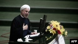 President Hassan Rohani speaks before the Iranian parliament in Tehran in mid-August.