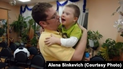 Aaron Moyer holds Vitaly during a visit to his Russian orphanage, before the adoption ban was instituted. Vitaly, who has Down syndrome and a life-threatening heart condition, still lives in an orphanage.