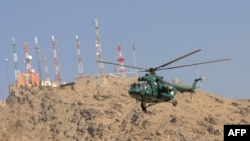 A Russian-made Mi-17 helicopter flies past during the opening ceremony of the Afghan National Civil Order Police headquarters in Kabul in January 2010.