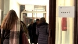 Kosovo - Teachers leaving the school during the strike