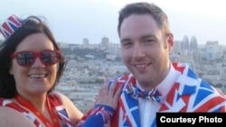 "British Eurovision scholar Paul Jordan (right), also known as ""Dr. Eurovision,"" posing with a friend in Union Jack outfits during the 2012 edition of the song contest in the Azerbaijani capital, Baku."