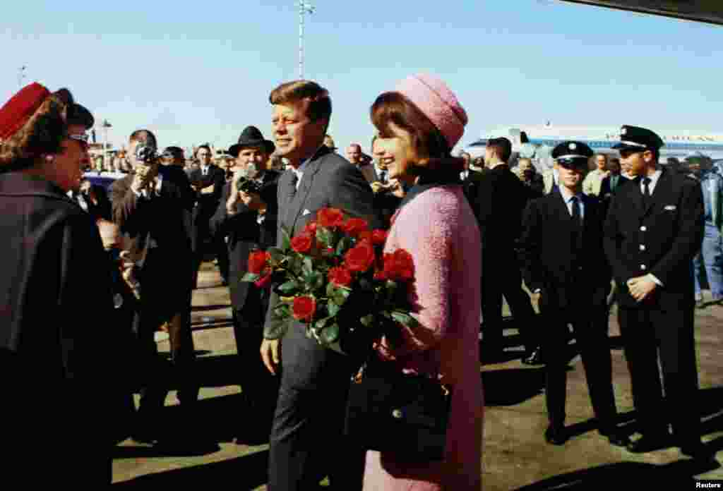 President John F. Kennedy and first lady Jacqueline Kennedy arrive at Love Field in Dallas, Texas less than an hour before his assassination.