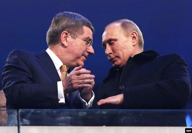 Томас Бах и Владимир Путин на церемонии открытия Олимпиады в Сочи, 7 февраля 2014 года