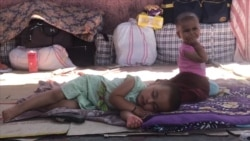 Desperate To Get Home: Tajik Migrants Stranded In Kazakhstan