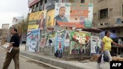 ملصقات دعائية لمرشحين في إنتخابات مجالس المحافظات ببغداد، نيسان 2013