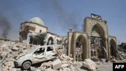 IRAQ -- A picture taken on June 30, 2017, shows the destroyed Al-Nuri Mosque in the Old City of Mosul, as Iraqi government forces continue their offensive to retake the city from Islamic State (IS) group jihadists. IS blew up the mosque and the famed Al-H