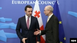 Georgian Prime Minister Irakli Garibashvili (left) with EU Council President Herman Van Rompuy in Brussels on February 4.